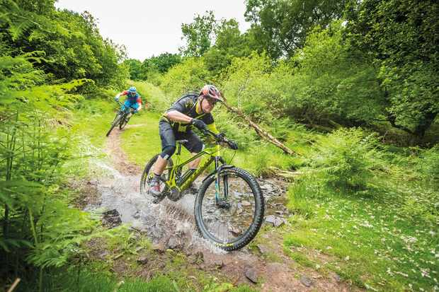 Tim Flooks and Max Darkins on an MBUK Big Ride on a water splash through the Quantocks