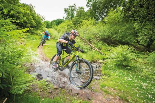 Tim Flooks and Max Darkins on an MBUK Big Ride on a water splash through the Quantocks