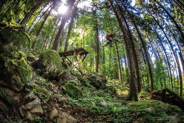 Vinny T sends it off one of the crazy features at his local trails near Evian