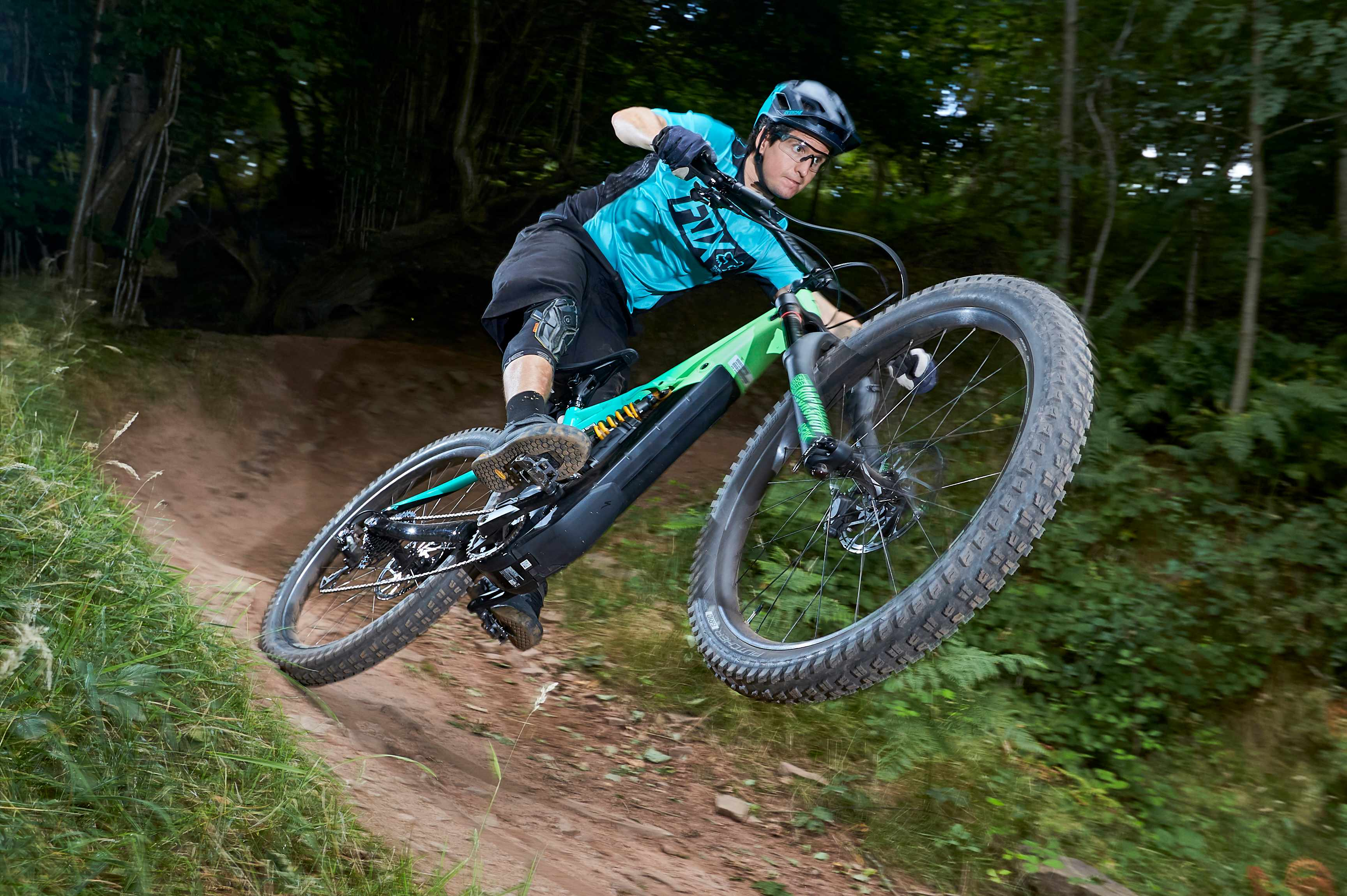 Staff Writer Luke rips a turn at Black Mountain Cycle Centre on the Specialized Kenevo e-bike, for the cover of MBUK, issue 360