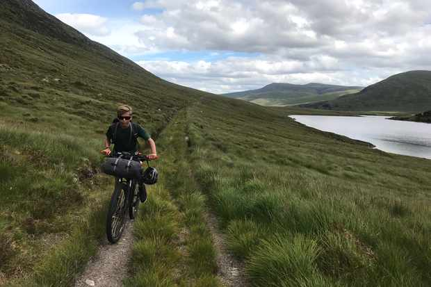 Billy pedalling up towards the watershed above Loch Choire