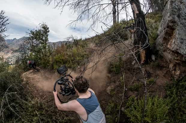 Filmer Robbie Meade using a steady cam rig to track the World Cup pace action. Photo: Duncan Philpott