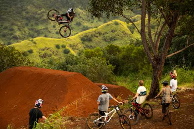 Ryan Howard airs over Thomas Genon, Reed Boggs, Matt Hunter, Ben Byers, and Brett Rheeder during filming of Oahu segment of Anthill's 'Return to Earth', Hawaii