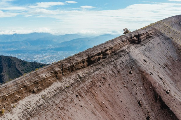 The crater on Mount Vesuvius is 305m deep and measures 610m across. The trail around the edge is not one for vertigo sufferers. Photo: Martin Bissig